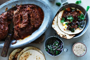 Beer-braisedshortribtacos with red onion salsa.