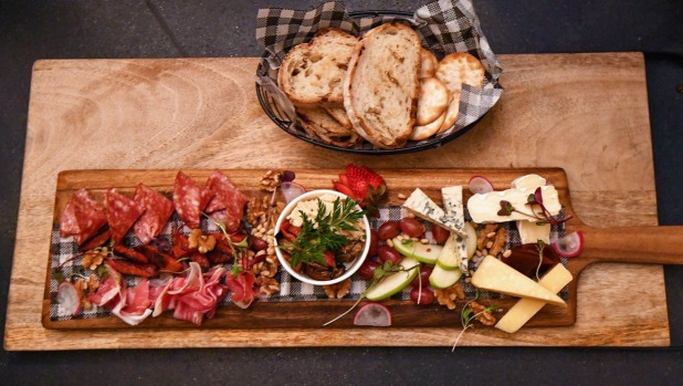 Cheese and charcuterie platters work well in the snug confines of the cottage.