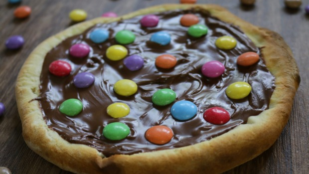 Stock photo of children's smarties chocolate pizza, topped with crunchy sugar coated rainbow sweets perfect for kid's birthday party cake or fun dessert at garden barbecue, homebaked bread pizza base. Sushi and 10 other things that don't belong on a pizza Sushi pizza iStock Barbecue sauce pizza Calamari pizza Chicken pizza Dried mixed herbs pizza Corn chip pizza Fresh tomato pizza Nutella pizza Egg pizza Unpitted olives pizza Anchovy pizza Pineapple pizza Tinned mushrooms