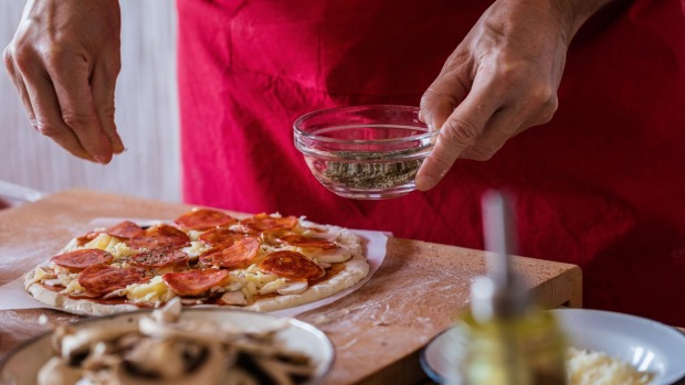 Pizza with dried herbs.