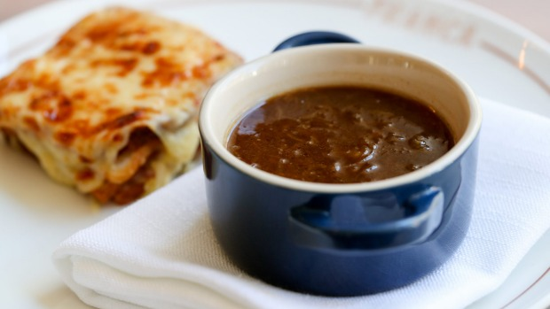 French onion soup comes with a croque-monsieur on the side.