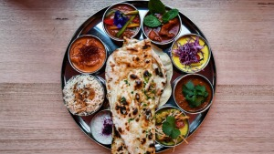 The vibrant thali tray of curries is just one course of the tasting menu.