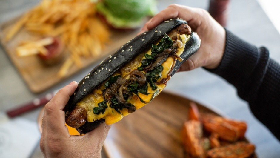 Heidelburger's Salsiccia, an Italian sausage, with sauteed silverbeet, caramelised onion and scarmorza cheese in a ...