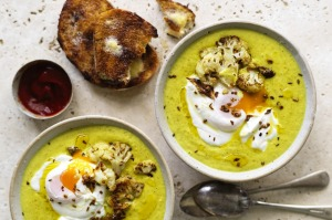 Karen Martini's roasted cauliflower and turmeric soup with yoghurt and poached egg.