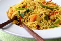 Curry powder gives Singapore noodles its signature golden colour.