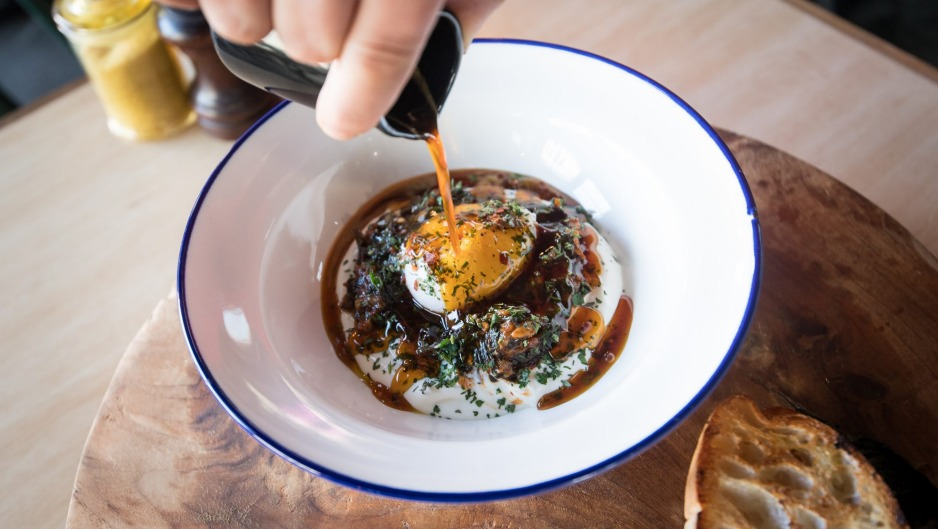 Cilbir - poached egg, yoghurt and wilted spinach with spiced burnt butter poured at the table.