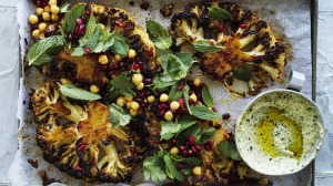 Thick cauliflower steaks slathered with a spicy harissa paste and roasted until caramelised.