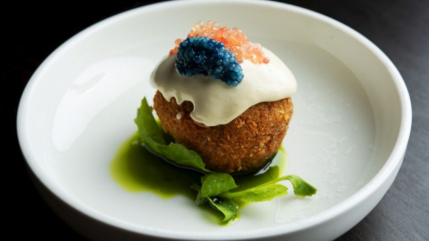 Spanner-crab rice ball with scampi caviar, finger lime, sate oil and oyster emulsion.