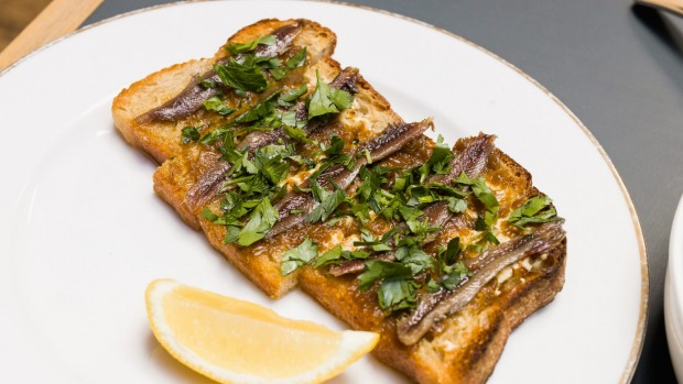 Anchovy, confit shallot and parsley on toast.