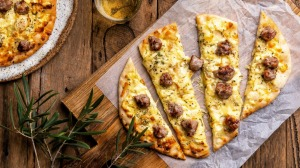 Pizza bianco with potato and sausage.