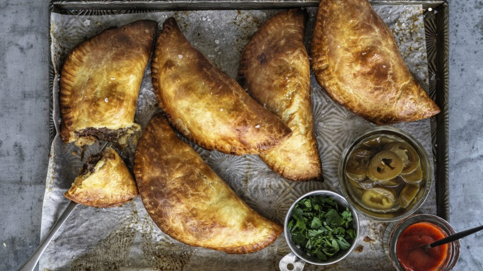 Empanadas filled with beef, chorizo and roasted tomatoes.