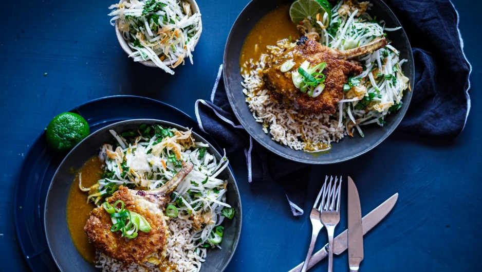 Crumbed pork cutlets with Japanese curry sauce, rice and kohlrabi, kimchi and coriander slaw.