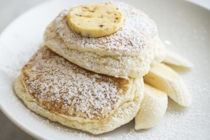 Ricotta hotcakes with banana and honeycomb butter.