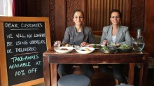 Almond Bar owners Sharon and Carol Salloum, who are offering customers a 10 per cent discount on takeaway instead of ...