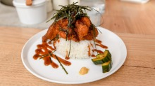 Musubi topped with panko-crumbed, deep-fried chicken.