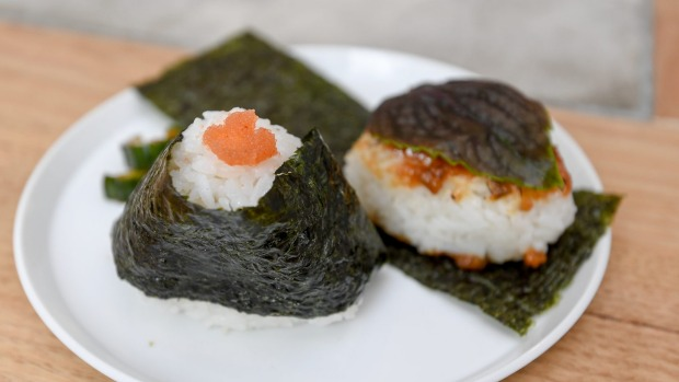 Simple musubi with mentai mayo (cured cod roe and Japanese mayo; left) and shiso leaf covered miso (right).