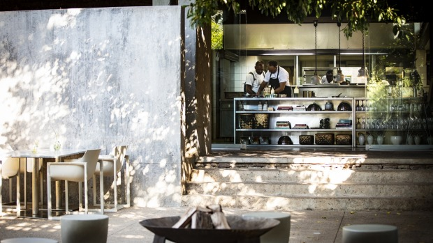 Guest cooking classes at Lebombo Lodge's interactive kitchen help generate funds to educate South African chefs.