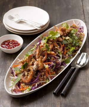 Share-friendly coleslaw with green papaya and crispy fried school prawns is a crowd-pleaser.