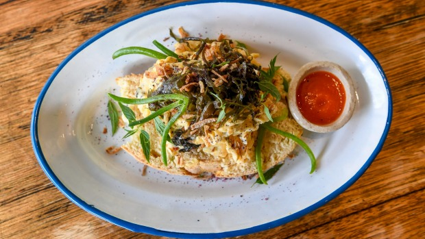 Seaweed scrambled eggs with manchego, crispy shallots and house-made organic sriracha.