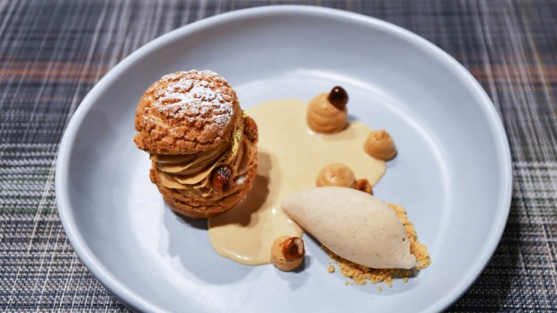 Choux pastry sandwiched with praline cream and served with praline ice-cream and custard.