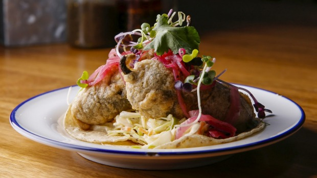 The fish tacos feature beer-battered swordfish-stuffed jalapenos.