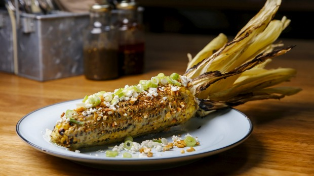 Grilled corn with chilli, garlic and cheese.