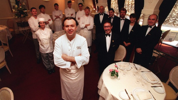 Philippe Mouchel surrounded by staff as they prepare for Bocuse restaurant's closure.