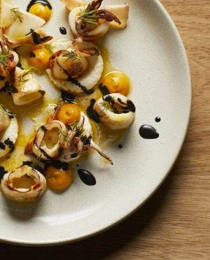 Grilled baby calamari, saffron and bacala from Osteria Ilaria.