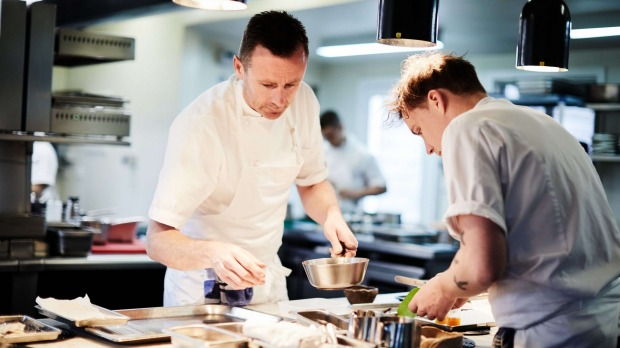 On a mission: Dan Hunter (left) in the kitchen at Brae.