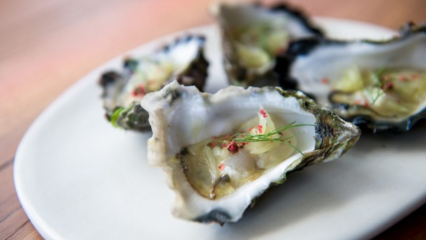Moonlight Flat oysters with pomello and pink peppercorn.