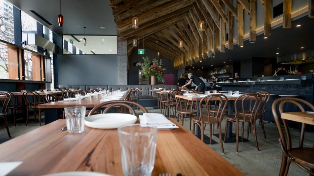 The restaurant has repurposed wooden beams from Bega Flats for the ceiling and tables.