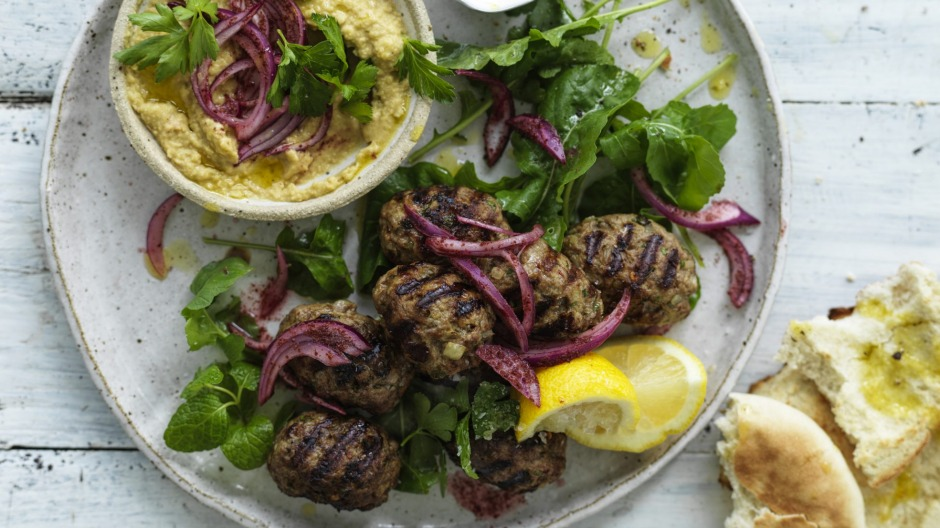 Neil Perry's lamb meatballs with onion salad and hummus.
