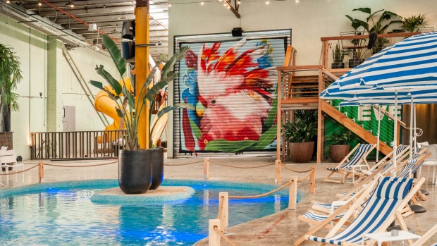 With itspinball room, hidden tiki bar, lagoon and waterfall, Moon Dog World offers a one-of-a-kind brewpub experience.