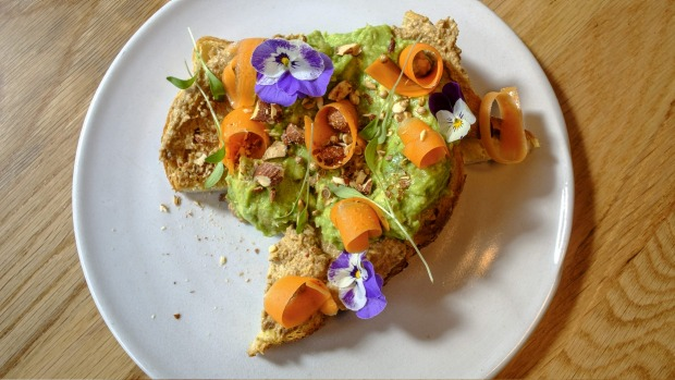 Avocado on toast with pickled carrot.
