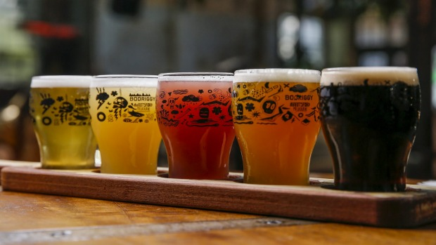 A tasting paddle of beer.