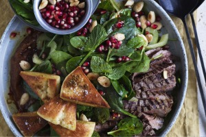 Grilled lamb salad with date paste, pomegranate and crunchy pita croutons.