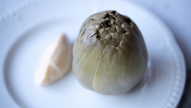 Boiled artichoke ready to be dissected and swished through bonito mayonnaise.