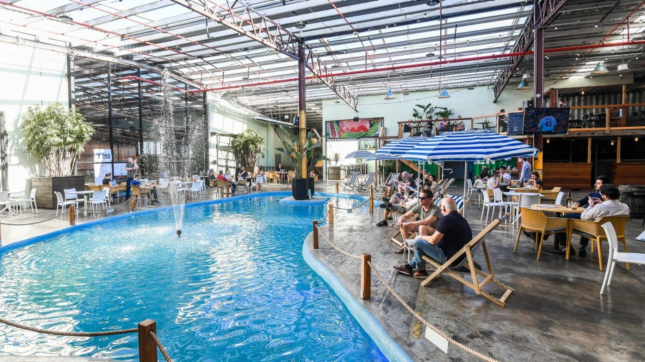 Moon Dog World features a public-pool-blue lagoon with a fountain.