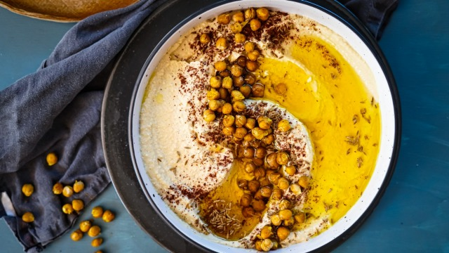 Swipe some flatbread through this preserved lemon hummus with crispy spicy chickpeas.
