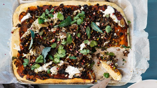 Lamb, maple, sumac and pistachio 'pizza' with tahini yoghurt and charred onions.