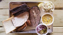 Beef brisket, turkey and hot link with creamed corn, jalapeno coleslaw and cucumber salad at Blood Bros.