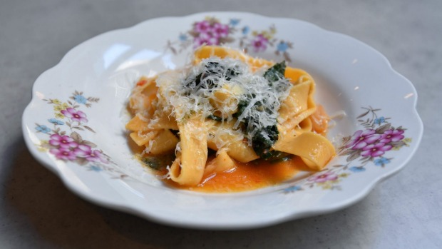 Fettuccine with wilted greens and chilli.
