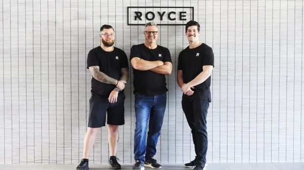 Ross Dobson (centre) at Cafe Royce with barista Anthony Brownlie (left) and waiter Ollie Masters (right).