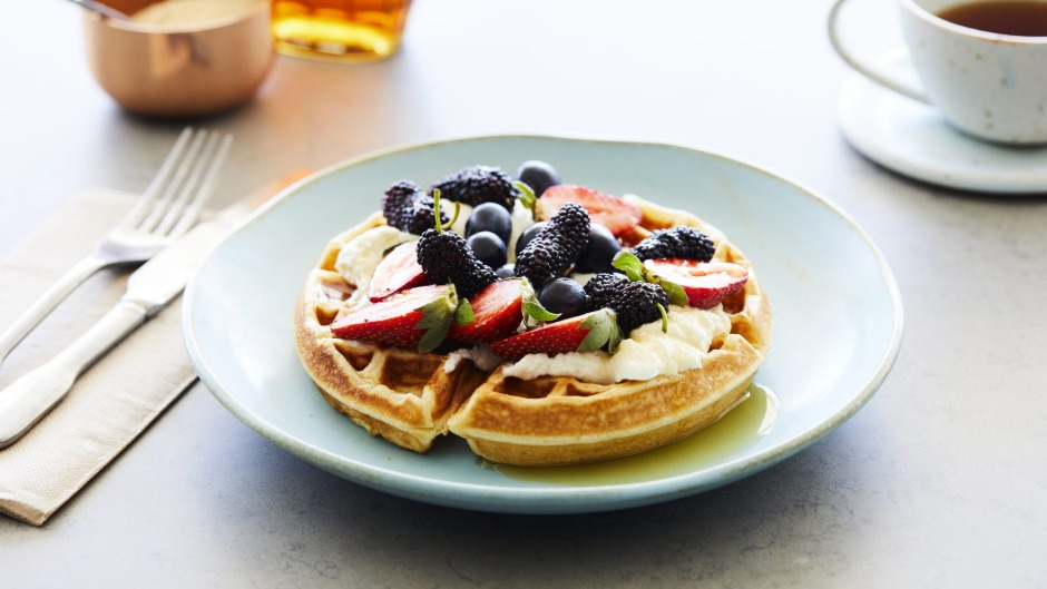 Waffles with fruit and labneh.
