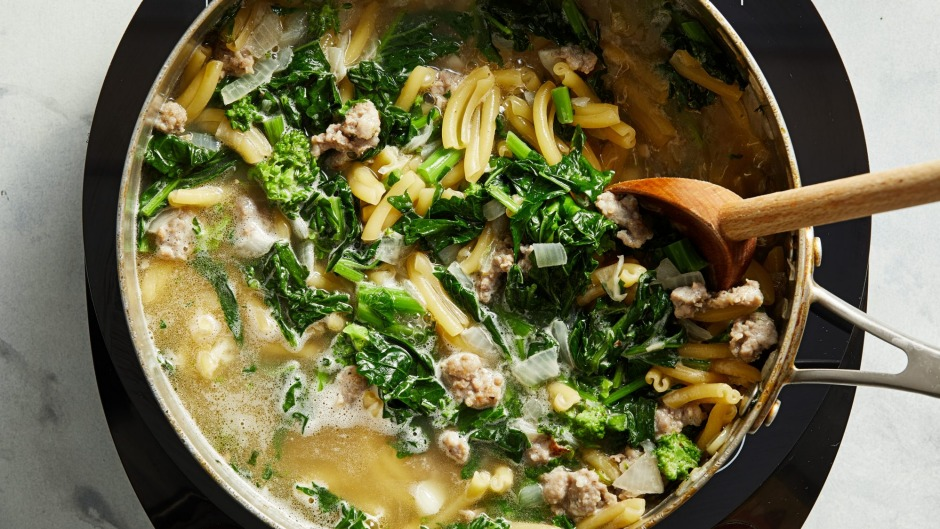 One-pot pasta in progress, with sausage chunks and broccolini.