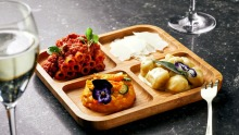 Mixed pasta plate, gnocchi four cheeses, candele bolognese and pumpkin and crab risotto with zucchini flowers.