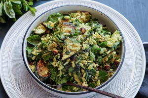 Charred zucchini, risoni and herb pasta salad with parmesan and pea dressing.