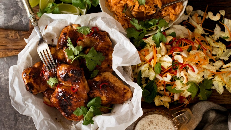 Vietnamese chicken served with red rice and coleslaw.