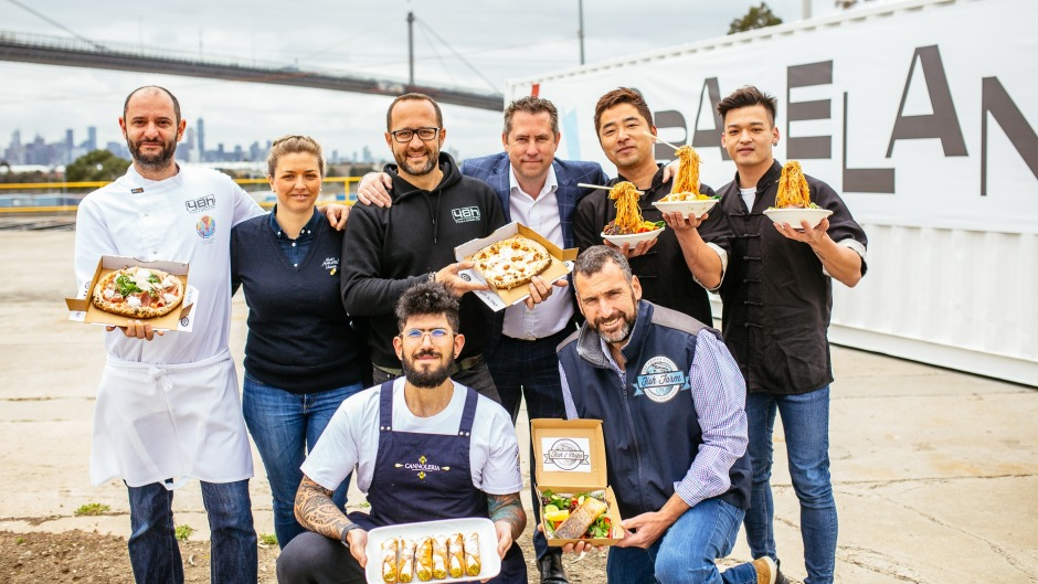 Managing director John Forman (third from right, standing) with other confirmed food vendors including Simon Shao's ...