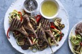Barbecued lamb cutlets with salad and mint jelly.
